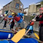 Young people taking part in watersport activity