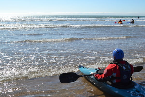 Young person canoeing