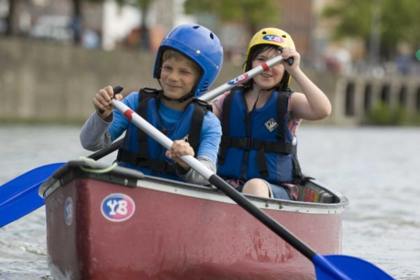 Two young people canoeing