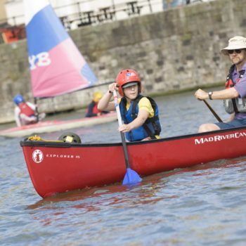 Young person and adult canoeing