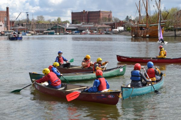 Groups of young people canoeing