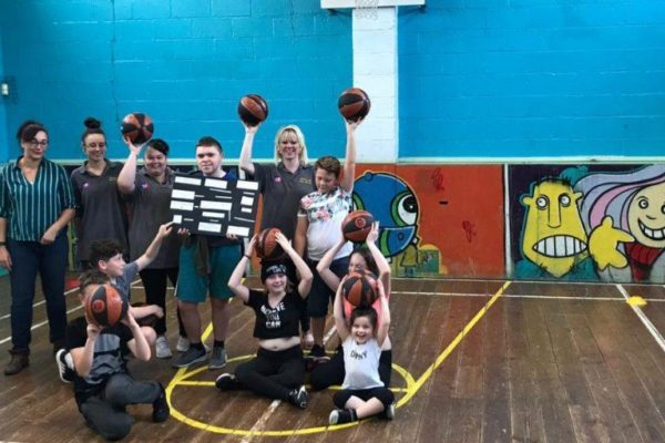 Young people with basketballs at Avon