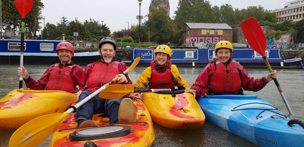 Older people kayaking group photo