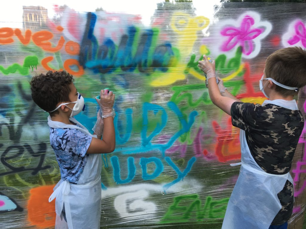 Young people taking part in graffiti session