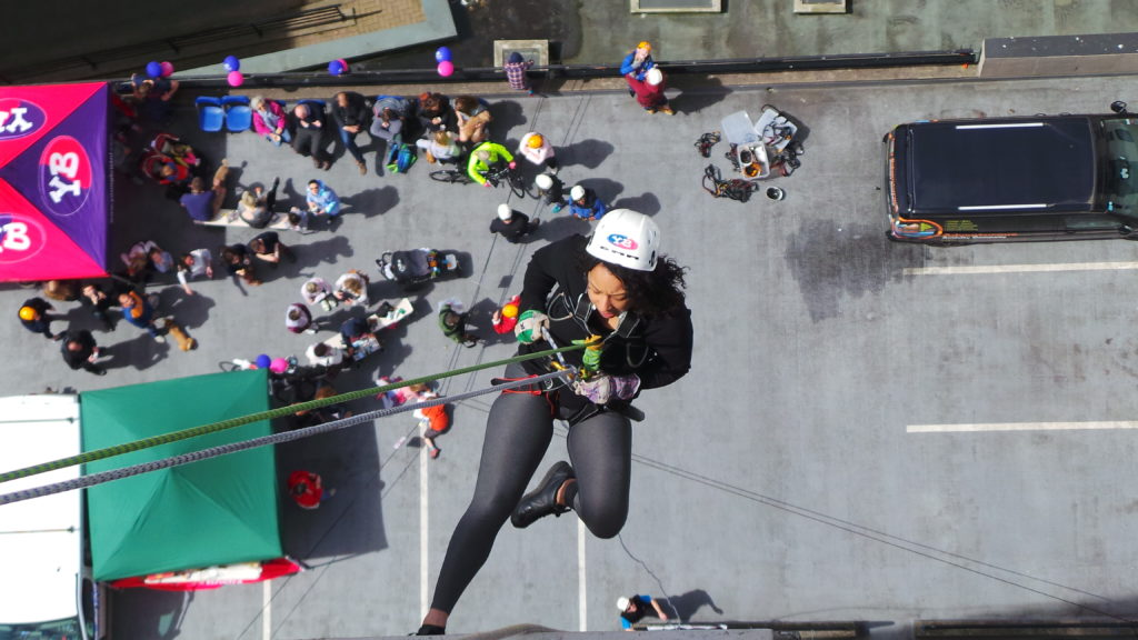 Woman abseiling Young Bristol fundraise